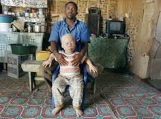 Zwelethu Mthethwa  South African; b. Durban, KwaZulu-Natal, South Africa, 1960  Untitled (Father and Son)  2002  color coupler print mounted on to UV-protected plexiglas with aluminum strainer  38 x 51 x 1 1/4 in. (96.5 x 129.5 x 3 cm)