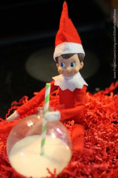 Elf on the Shelf Ideas –  Elf Drinks from an Ornament. Thish and more funny elf on the shelf ideas as well as FREE Printable Notes on Frugal Coupon Living.