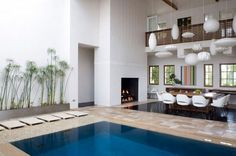 Dinning room with fireplace and swimming pool. Crazy cool!
