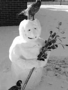 Snow man with crow on head...