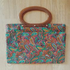 Vintage 1960s MOD adjustable paisley purse Vintage handbag with button snaps to adjust size. Lucite handle. Brand: Lady's Pride. I bought this deadstock with tags and only used it once. Bags