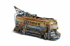 UNTITLED (TOBLERONE TROLLEY), Willem van Genk, c. 1980–2000, tin cans, cardboard, metal, paint, paper, and plastic,10 x 19 x 5 1/8 inches (25,5 x 48 x 13 cm), collection Foundation Willem van Genk, Museum Dr. Guislain, Ghent, 21030241 Photo: Guido Suykens
