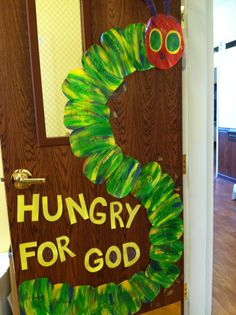 Very hungry caterpillar door...caterpillar looks easy to make for decoration.