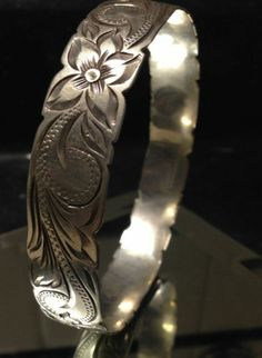 Not sure about the floral pattern, but overall I like this etching style. I love how it is a band, but the edges are notched with the design.