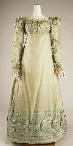 Dress ca 1820.  American silk  subtle contrast piping. ornate tied sleeve heads, heavy decorative band round hem.