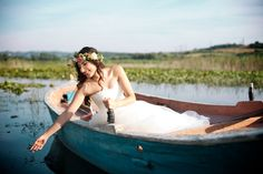 A romantic farm wedding shooting with wooden boat, flower crown and a lovely couple among lotus...