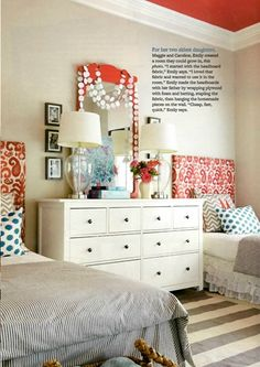 Small space solution - use a large dresser between two beds.  Fun pattern mix too.
