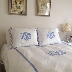 Matouk bedding with blue monogrammed shams and duvet. Matouk bedding can be ordered at Material Things.