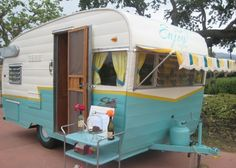 cute yellow and teal retro camper