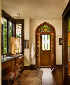 Windsor Residence- Beautiful, old world style bathroom. I love the wooden floors in the bathroom.
