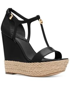 MICHAEL Michael Kors Kerri Wedge Sandals $150.00 Step up your style with the sleek, T-strap design and skyscraper heel on these Kerri platform wedges from MICHAEL Michael Kors.