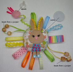 For your baby this toy. Toy ready for shipment! Makes a wonderful travel toy whether on a lap in the car seat or stroller, a quiet busy activity while waiting for appointments and a lovely baby shower gift. This toy is bright. The child may palp toy and pull in different directions. Toy can jingle if it shake. Toy squeaks if you press on flower. In the toy has beads from a juniper. Beads of juniper specifically for toys. They can take by mouth. They smell. In the toy has a large beautiful…