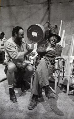 John Rhys Davis & Harrison Ford, laughing on set of first Indiana Jones movie.