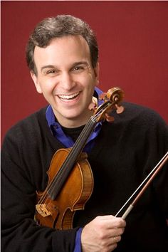 Violinist Gil Shaham! Here he speaks about violin concertos of Korngold, John Williams and Bright Sheng: http://www.violinist.com/blog/index.cfm?start=15064