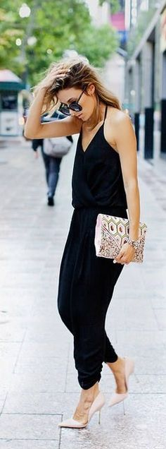 Black halter jumpsuit and nude pumps — a combo that never fails.