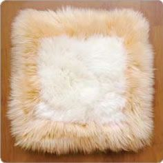 Our own single sided Longwool Lambskin flat cushions make a statement of Luxury. Every Home Needs a Lambskin cushion.