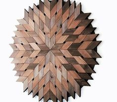 MADE TO ORDER This amazing circle wood sculpture is made from upcycled Western red cedar. Size is a large 40 inches in diameter. Each piece has been cut, sanded, stained and glued to a mahogany backing. The way the pieces have been arranged, creates tiny diamond shaped cut-outs between them. This adds depth to the wall sculpture. A real statement piece which would look great in any decor. This piece has a rustic, yet modern appearance. Stained in rich tones of pecan and walnut Finished...