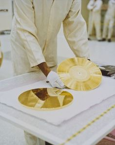 """The Voyager """"Golden Record"""" was assembled by Carl Sagan and the album's """"earth sounds"""" included recordings of things like music, surf, animals, and foreign languages, as well as playing instructions for aliens."""