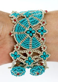 * inspiration for the tila wiggle, silver tilas, turquoise twins, red seed beads.