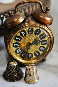 Vintage french alarm clock and thimbles http://folakeminuggets.blogspot.com/p/booking.html