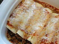 Easy Enchiladas (Beef or Chicken) from Food.com:   These easy enchiladas are my husband's favorite recipe of mine. Because of the many different options, it is very versatile.