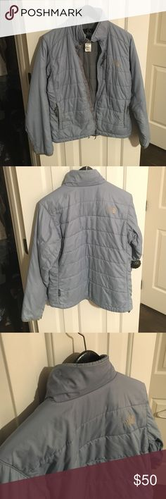 The North Face winter coat Comfortable, medium-lightweight jacket by The North Face. In decent condition, with a tiny bit of wear around the ends of the sleeves and a small stain on the collar in the back (as seen in photos). The color is an light, neutral gray-blue. Size small, but can fit a small-medium. The North Face Jackets & Coats Puffers