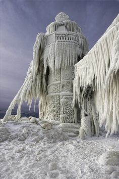 A lighthouse stands frozen still after a big storm in St Joseph, Michigan. //I love the look of the ice encasing the lighthouse EL// All Nature, Amazing Nature, Lac Michigan, Michigan Usa, Michigan Travel, Northern Michigan, Winter Wonder, Winter Scenes, Belle Photo
