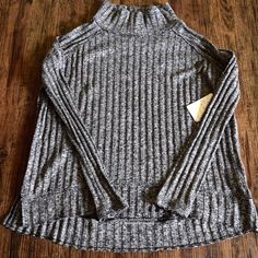 "FREE PEOPLE Top Oversized Slouchy Loose Knit Rib Size XS. New With Tags. $78 Retail + Tax.   Black/gray lightweight ribbed turtleneck with high low hem and raw trims.  Loose fit.  Cotton, polyester, spandex.    Measurements for Size XS: Bust: 44"" Length: 24.5"" Sleeve Length: 20""  ❗️ Please - no trades, PP, holds, or Modeling.    Bundle 2+ items for a 20% discount!    Stop by my closet for even more items from this brand!  ✔️ Items are priced to sell, however reasonable offers will be…"
