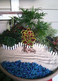 Beach fairy garden.  Just need a beach chair and umbrella!