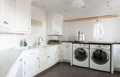 Laundry room with white shaker cabinets paired with honed white marble counterto. Laundry room with white shaker cabinets paired with honed white marble countertops and a white subw Dering Hall, Laundry Drying, Laundry Mud Room, White Marble Countertops, Shaker Cabinets, Laundry Design, Drying Room, White Shaker Cabinets, White Subway Tile Backsplash