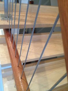 Interior staircase with vertical cable railing- custom wood top and bottom rail with stainless steel cable filled in vertically. http://stainlesscablerailing.com/cable-rail-infill-systems-photo-gallery.html