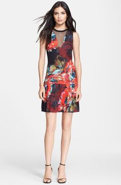 Free shipping and returns on Trina Turk Mesh Inset Print Georgette Dress at Nordstrom.com. A pane of sheer mesh creates the plunging V-neckline of this silken georgette dress abloom in impressionistic flowers. Its drop-waist pleated skirt affords swingy movement.