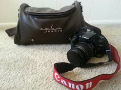 This is used but very good condition Digital SLR camera by Canon, EOS 400D. Black body comes with a EFS 18-55mm lens, a camera carry bag, a battery charger, a camera manual booklet, and a memory...