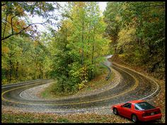 Red FC Rx-7 at a hairpin, probably at the Tail of the Dragon. Deals Gap