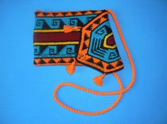 Crochet tapestry Bag, Native American Wayuu Bag style bag shoulder tote tassels bag crossbody bag twisted handle Inspired by traditional Indian motifs this bag is hand-crocheted in crochet tapestry pattern and is absolutely amazing. Bright colors are my favourite to work with! It is fully lined inside with bright orange cotton fabric that brightens this bag up. Interior has one open fabric pocket. Top flap closes with silver-tone magnetic snap. Three decorative tassels on the flap add…