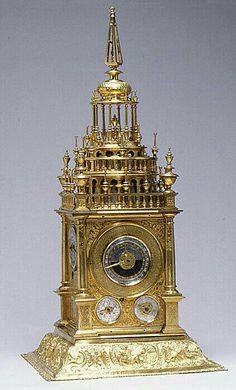 Extraordinary Astronomical table-clock terminating with an obelisk-shaped finial. Date: first quarter 17th century ; German, Augsburg. The case of gilt bronze and gilt brass; dials partly of silver and partly of gilt brass; movement of gilt brass and steel.