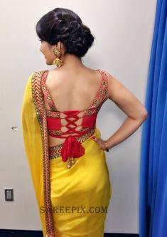 Raashi khanna backless in transparent saree photos. She looks eye catchy in saree with sleeveless blouse. Saree Blouse Neck Designs, Fancy Blouse Designs, Choli Designs, Stylish Blouse Design, Stylish Sarees, Saree Look, Indian Designer Outfits, Indian Outfits, Woman Outfits