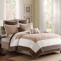 Transform your master suite or guest room with this timeless coverlet and pillow set, featuring stitched detailing on a concentric stripe background.  ...