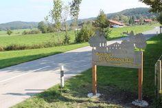 Willkommen im Goldenen Tal - Ortseingangsschild der UWG