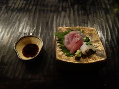 Striped horse mackerel and squid sashimi from the town's Nishiki port.