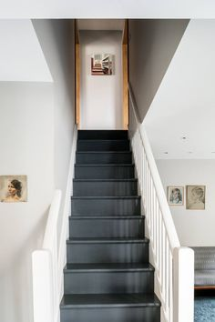 gray flooring The walls throughout are painted French Grey from Little Greene, and the stairs are a dark gray standard floor paint. Small Space Living, Small Spaces, Foyers, Black Stairs, Black Painted Stairs, Dark Staircase, Spiral Staircases, Grey Hallway, Painted Staircases