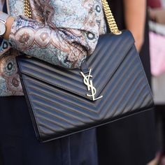 """""""Spotted! Our #SaintLaurent classic monogrammed shoulder bag out at #LFW. Shop it on #MATCHESFASHION.COM. (search 1021857)"""""""