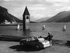 The Reschen Lake in southern Tyrol, which covers the sunken village of Graun, on August 13, 1953.