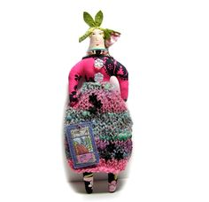 Theresa Hutnick - Textile cloth art doll with a rose bud on top of her head  http://www.etsy.com/transaction/94633688