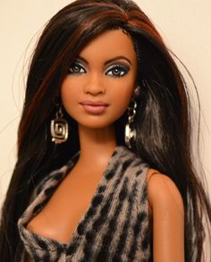 Saia is a fully repainted OOAK Barbie. All artwork was done by Doll Anatomy.
