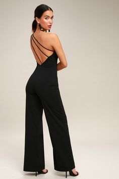 Lulus Exclusive! The perfect all-in-one outfit starts with the Going Solo Black One Shoulder Backless Jumpsuit! An asymmetrical neckline, made from sleek stretch knit, tops a fitted bodice and high waist. Bold, wide-leg pants drape below. Three thin straps dart across a sexy open back. Hidden side zipper/clasp.