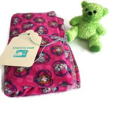 frozen baby blanket tied with created by laura tag and displayed with bear