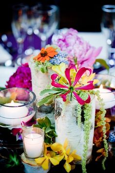 Birch Tree Stump Centerpiece: Mokara Orchids, Gloriosa Lilies, & Hyacinth amongst Candlelight Tree Stump Centerpiece, Tree Stump Table, Table Centerpieces, Wedding Centerpieces, Wedding Decorations, Table Decorations, Tree Stumps, Wedding Ideas, Gloriosa Lily