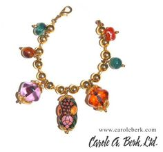 Gold tone  bracelet with resin charms. $125.
