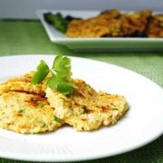 CHEESY, VEGGIE, QUINOA FRITTERS THAT ACT AS A WONDERFUL WARM SIDE DISH, COLD SNACK. I USE COCONUT OIL IN THE PAN.